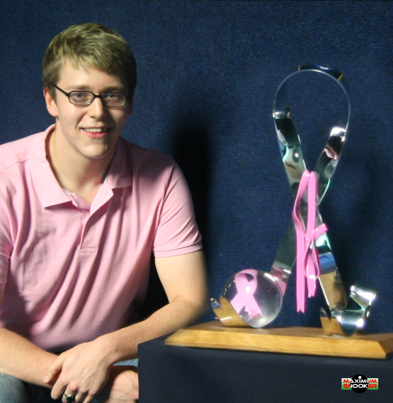 Stephen Kent plus pink ribbon trophy